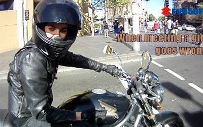 A biker tries to seduce a girl biker at a red light