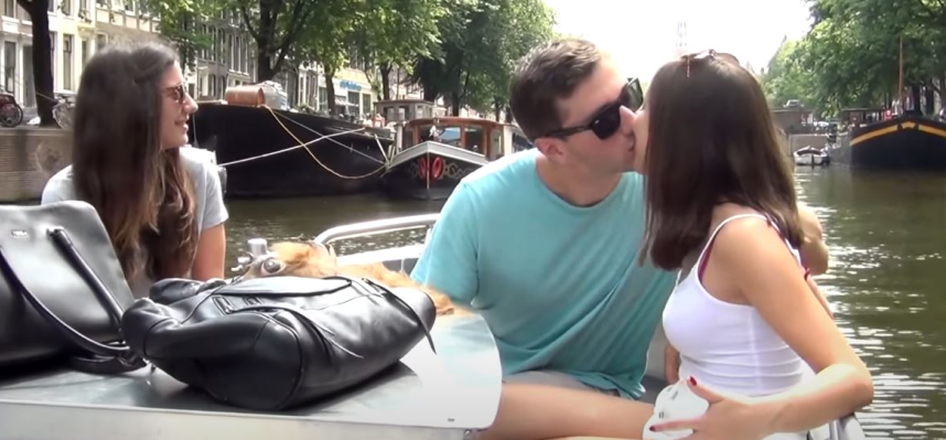 Brian kisses a girl in his boat